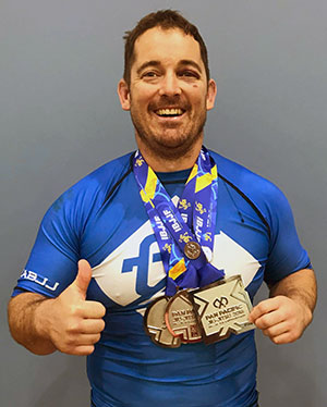 Dean wins 3 Pan-Pacs medals